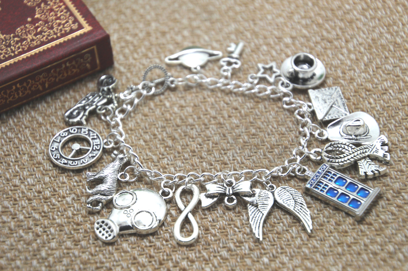 12pcs Doctor Who inspired bracelet Planet Key Teacup Police box Bow tie Wolf Infinity charm bracelet